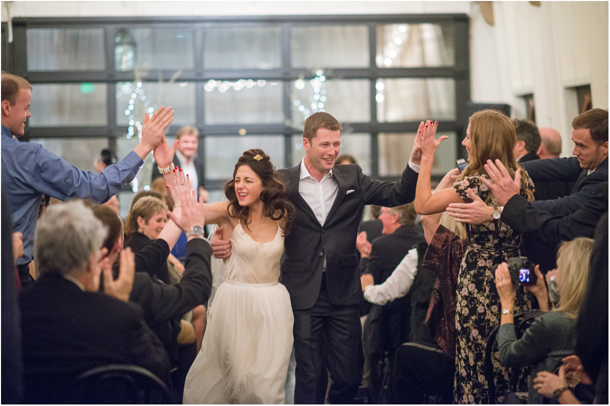 awesome bride and groom high five guests Salt and Pine Photography Seattle Wedding Photographers MV Skansonia Seattle Wedding Venue