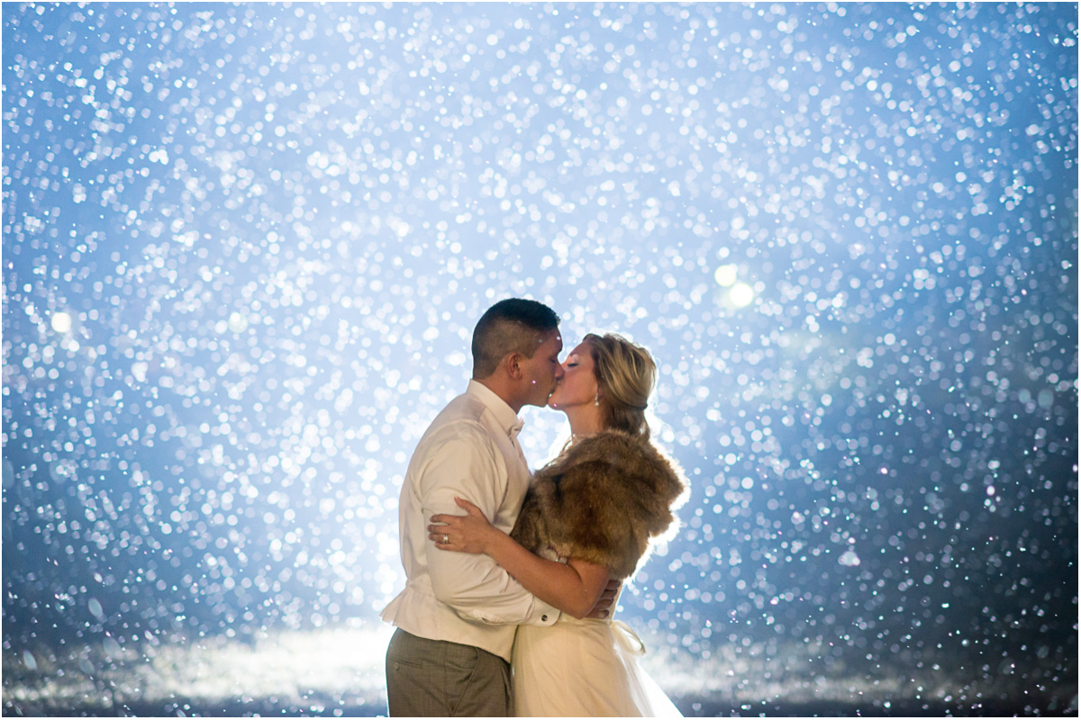 bride groom kissing as snow falls Seattle Wedding Photographers Salt and Pine Photography