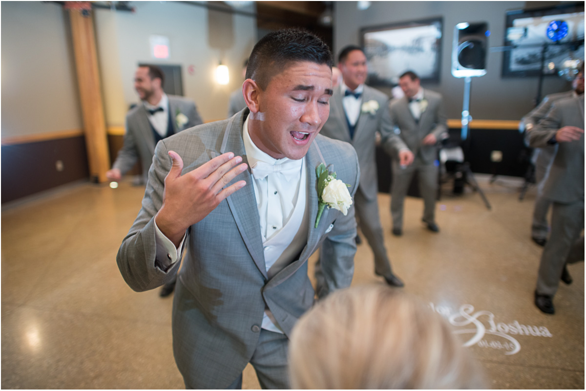 groom surprises bride with dance Seattle Wedding Photographers Salt and Pine Photography