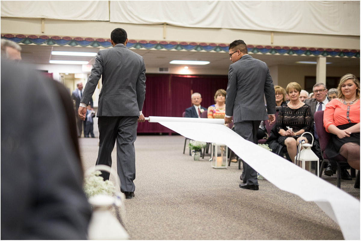 ushers laying aisle runner