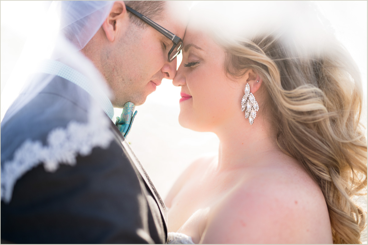bride and groom under veil wedding photo