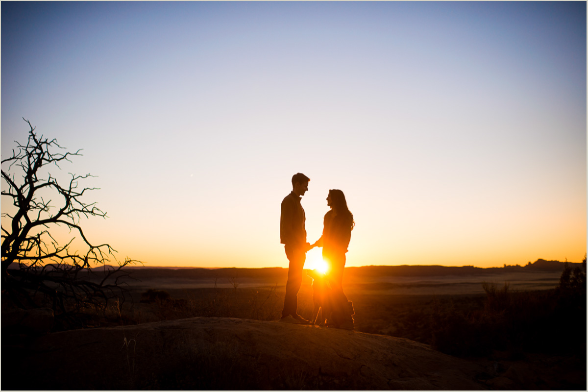 sunset in arches moab national park engagement session