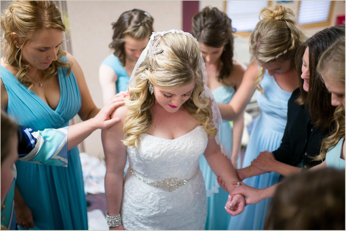 women praying over bride before wedding ceremony