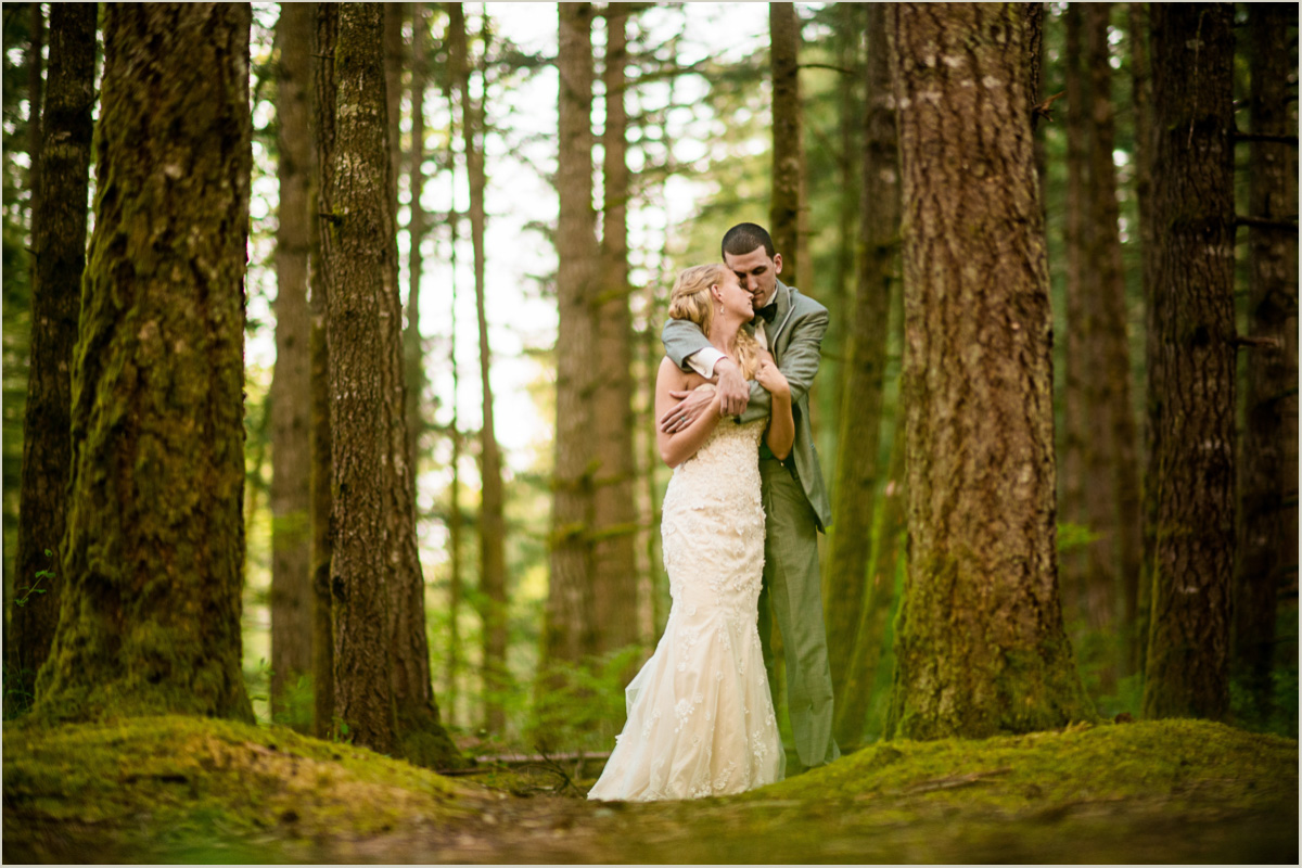 Bride and Groom Embrace Intimate backyard wedding in Black Diamond Washington