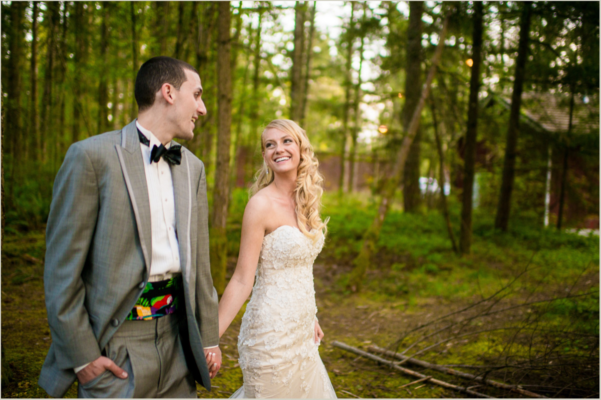 Bride and Groom walking in forest together