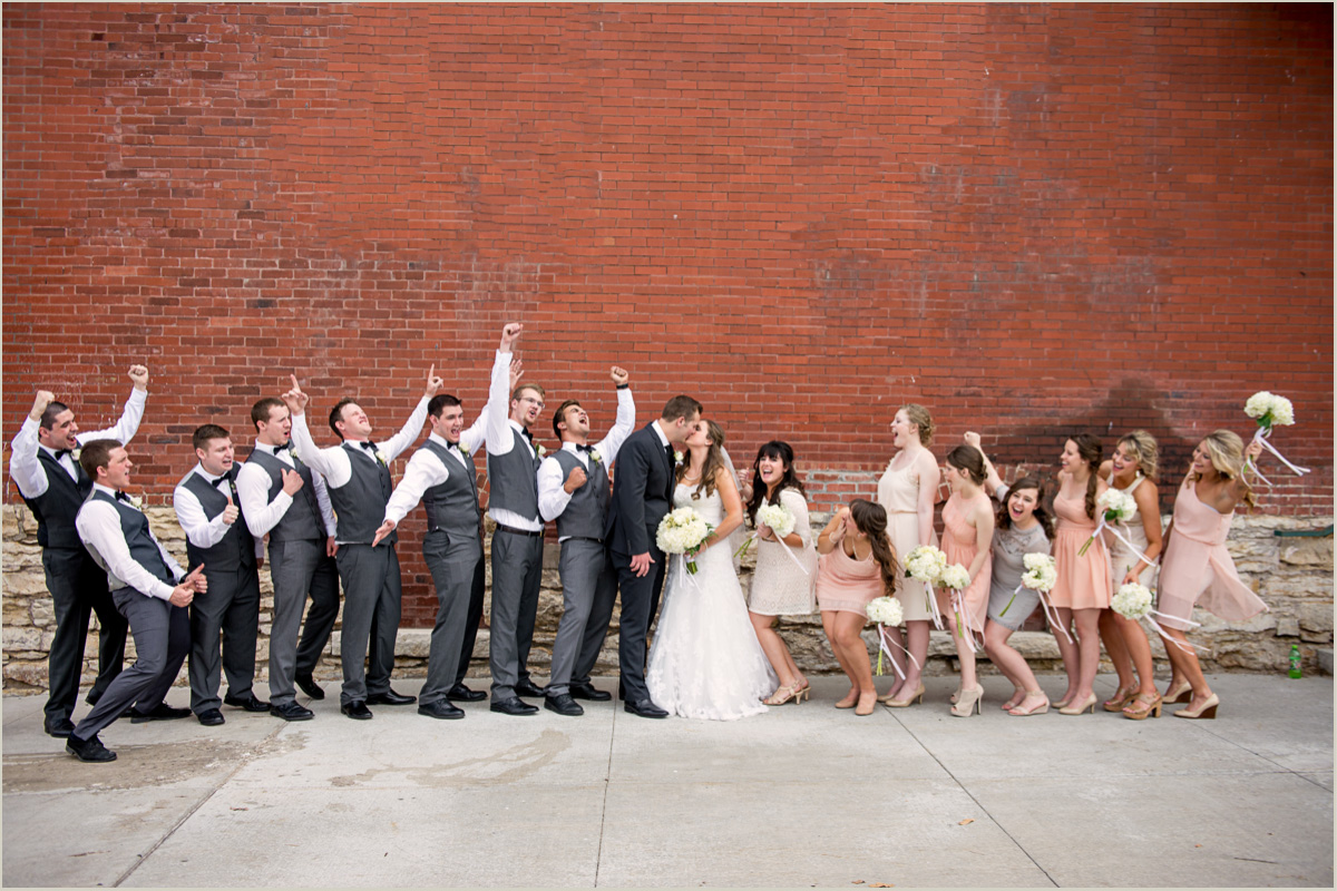 wedding party cheering because you left time for creative bridal party photos in your wedding day timeline