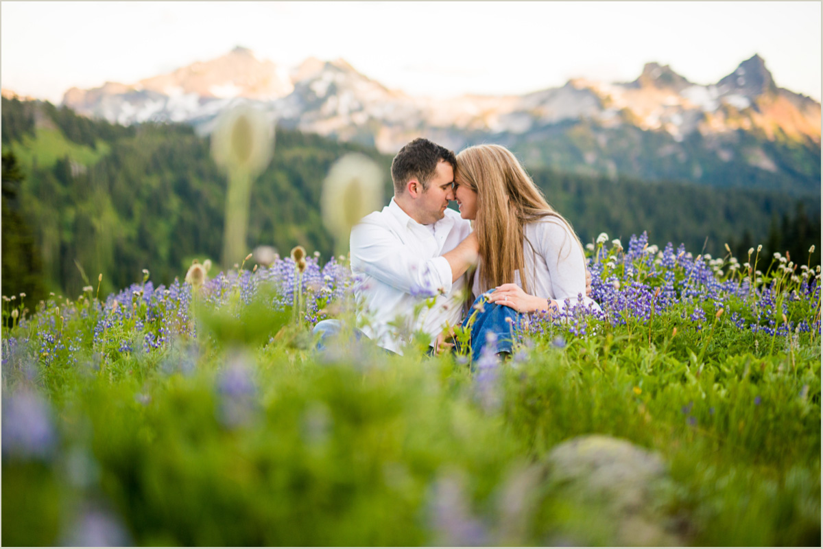 Couple Sitting in Wildflowers at Paradise Mount Rainier Alpine Meadow