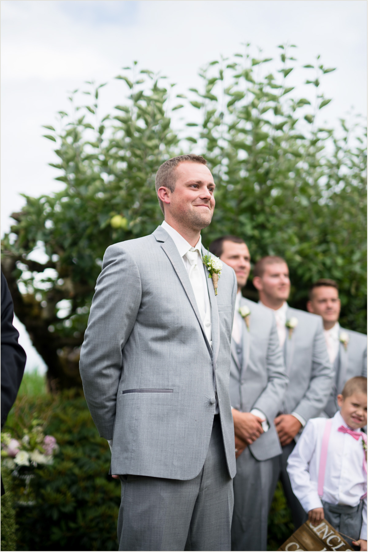 Emotional Groom Watching Bride Walking Down Aisle
