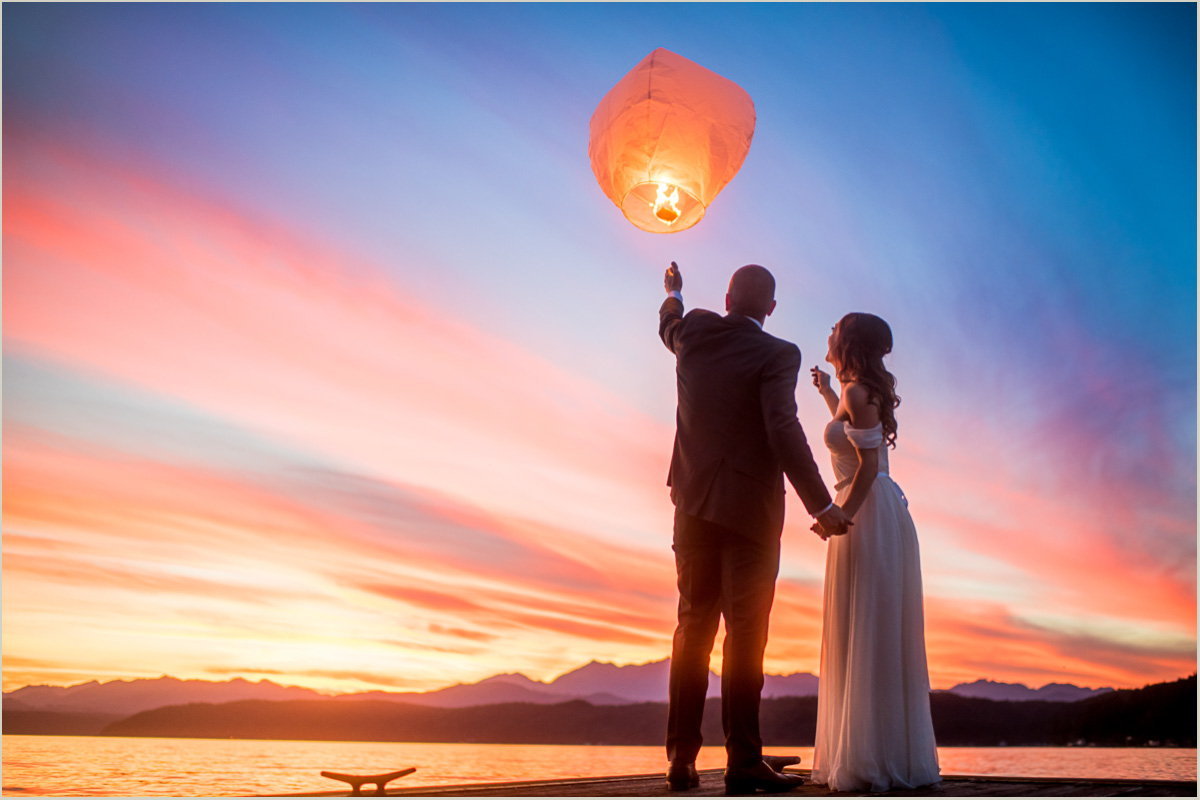 Husband and Wife Release Lantern at Robin Hood Village Resort Wedding - Copy
