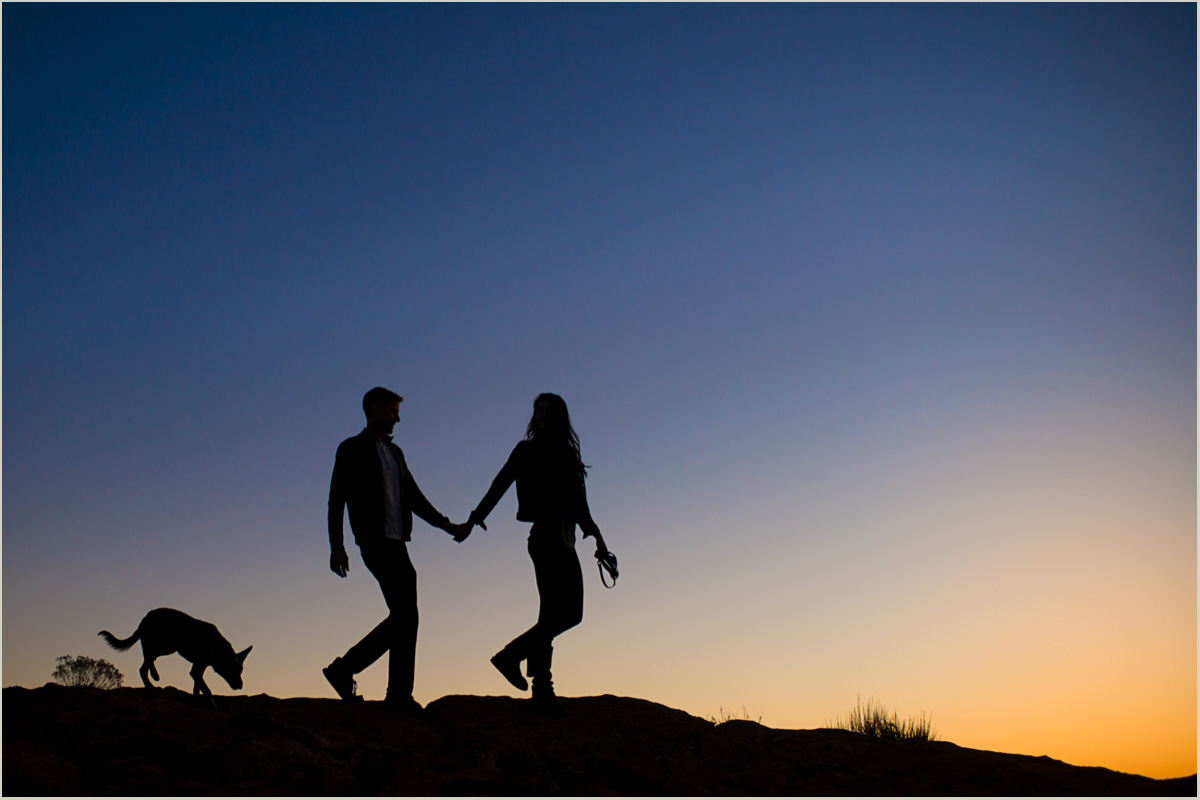 Silhouette of Couple Walking with Dog