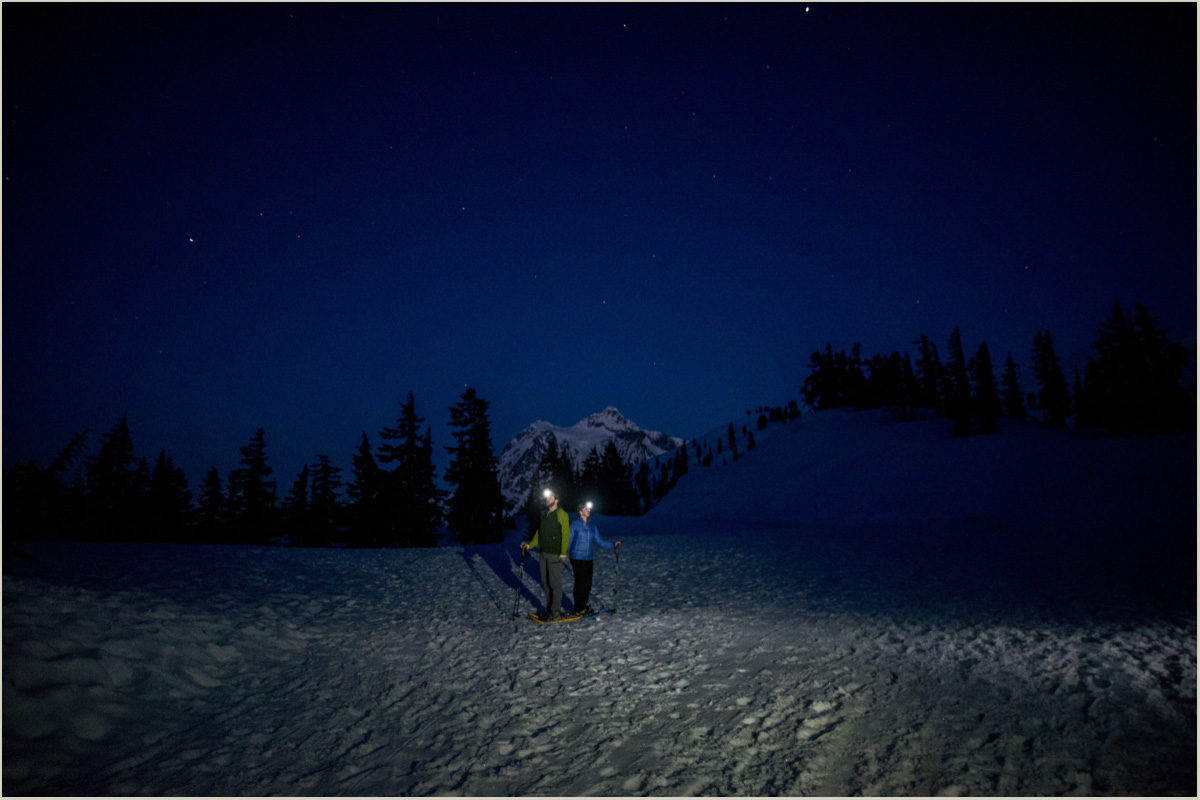 Engagement Photos at Artist Point in the Winter Snowshoeing under the stars