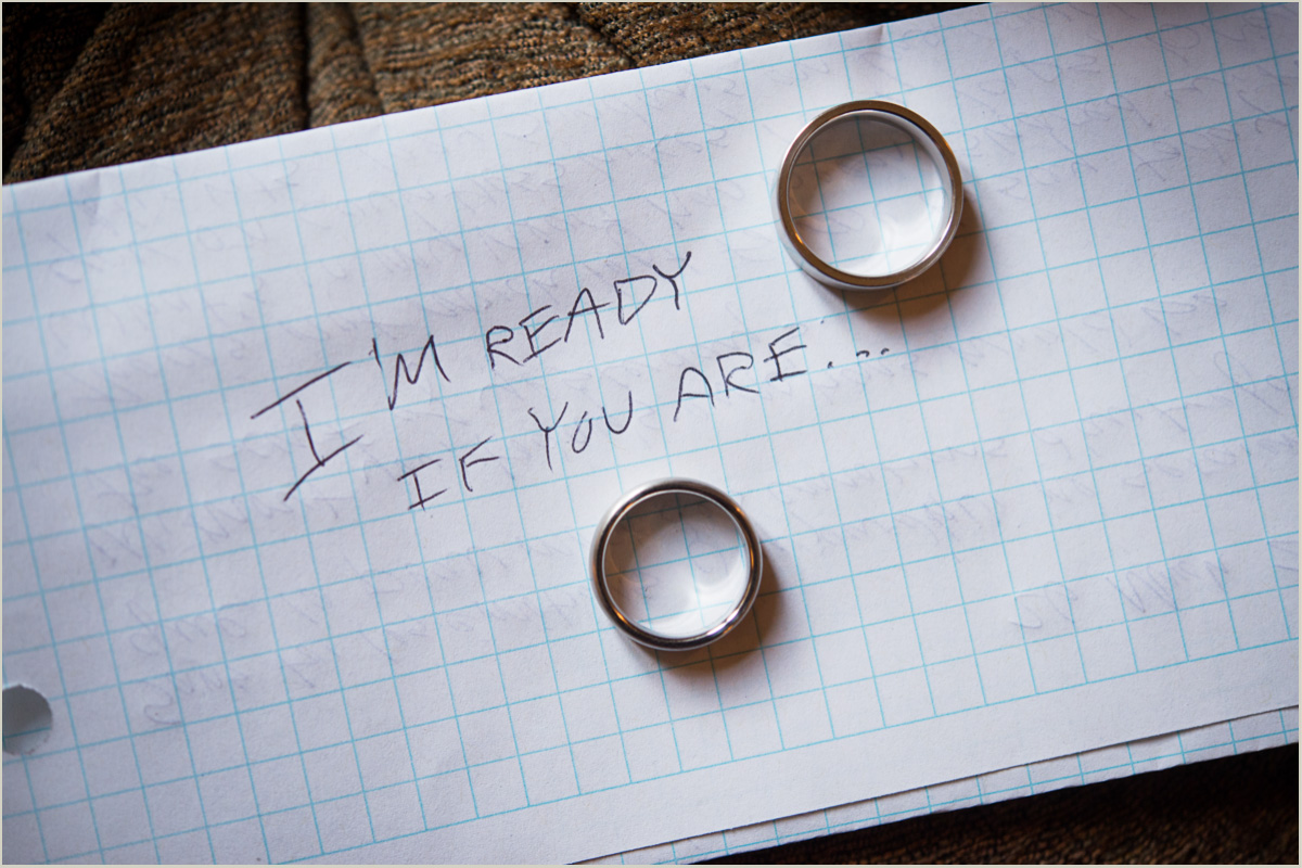 Handwritten Note with Wedding Bands