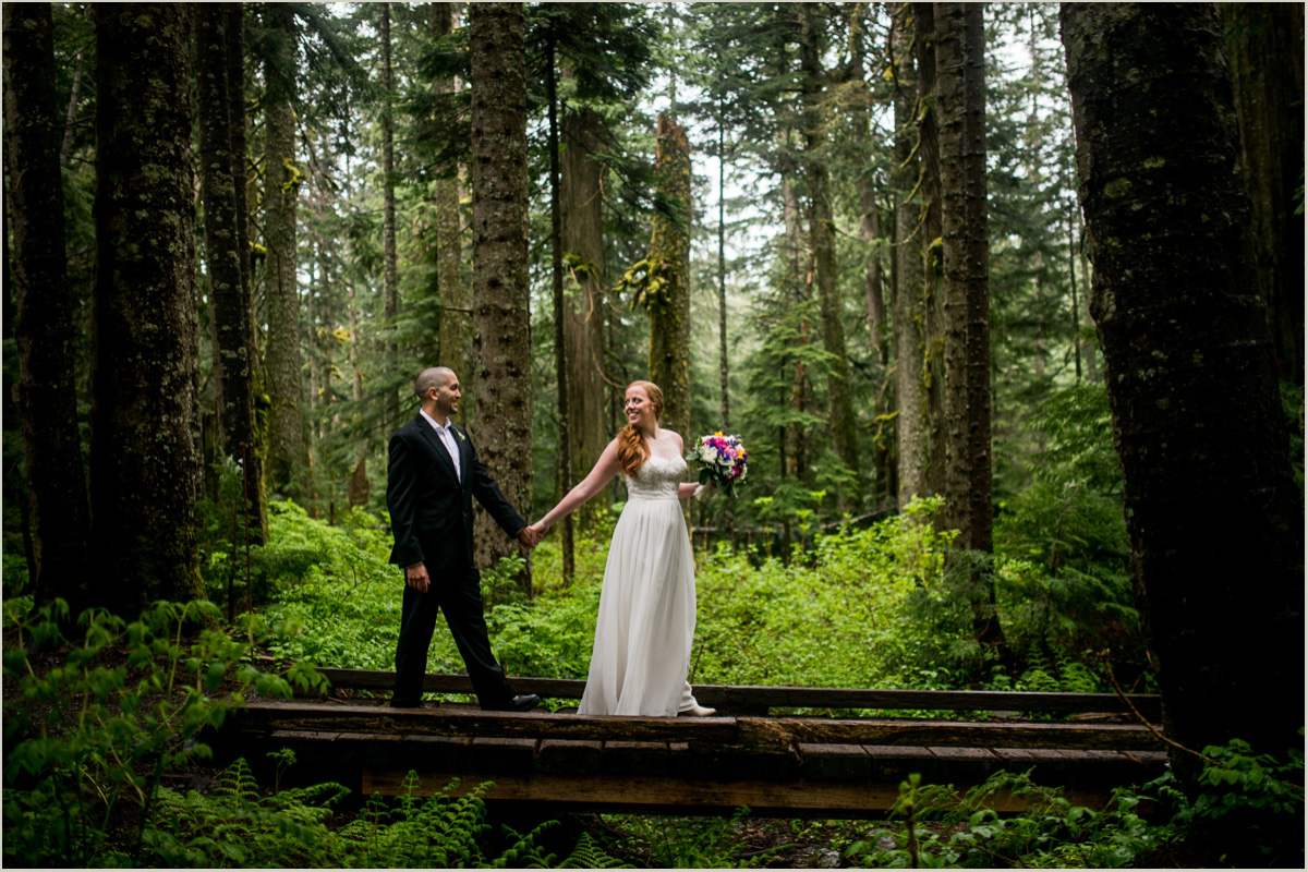 Bride leading her Groom Across a Bridge on Hiking Trail