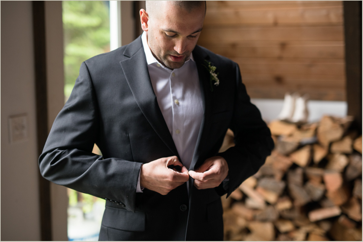 Groom Buttoning Tux