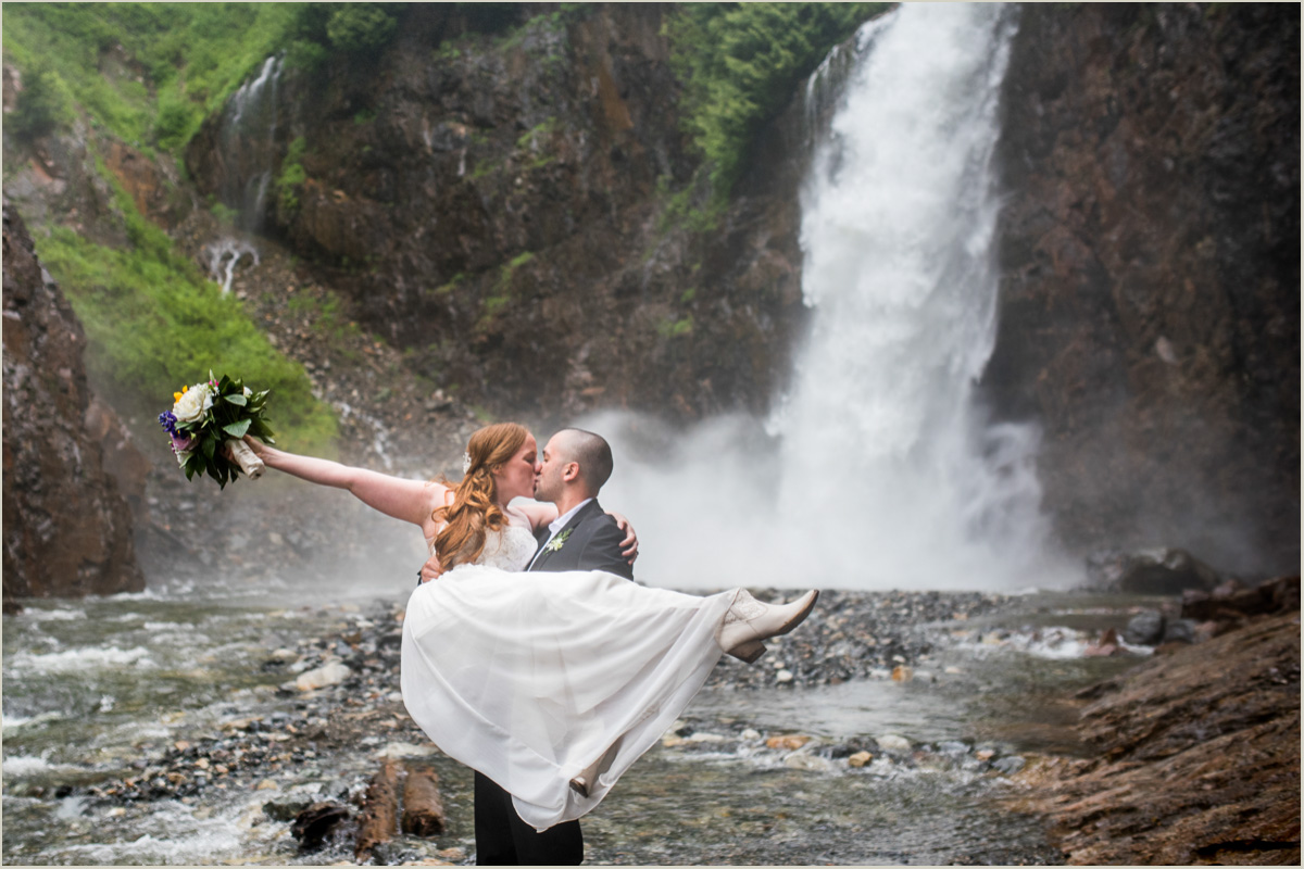 Wedding Couple Kissing in Front of PNW Waterfall