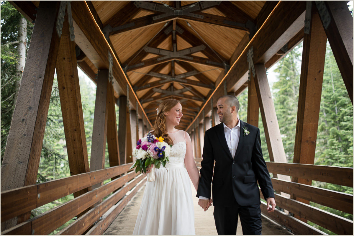 Wedding Couple Walking on the Covered Bridge at Alpental Ski Lodge