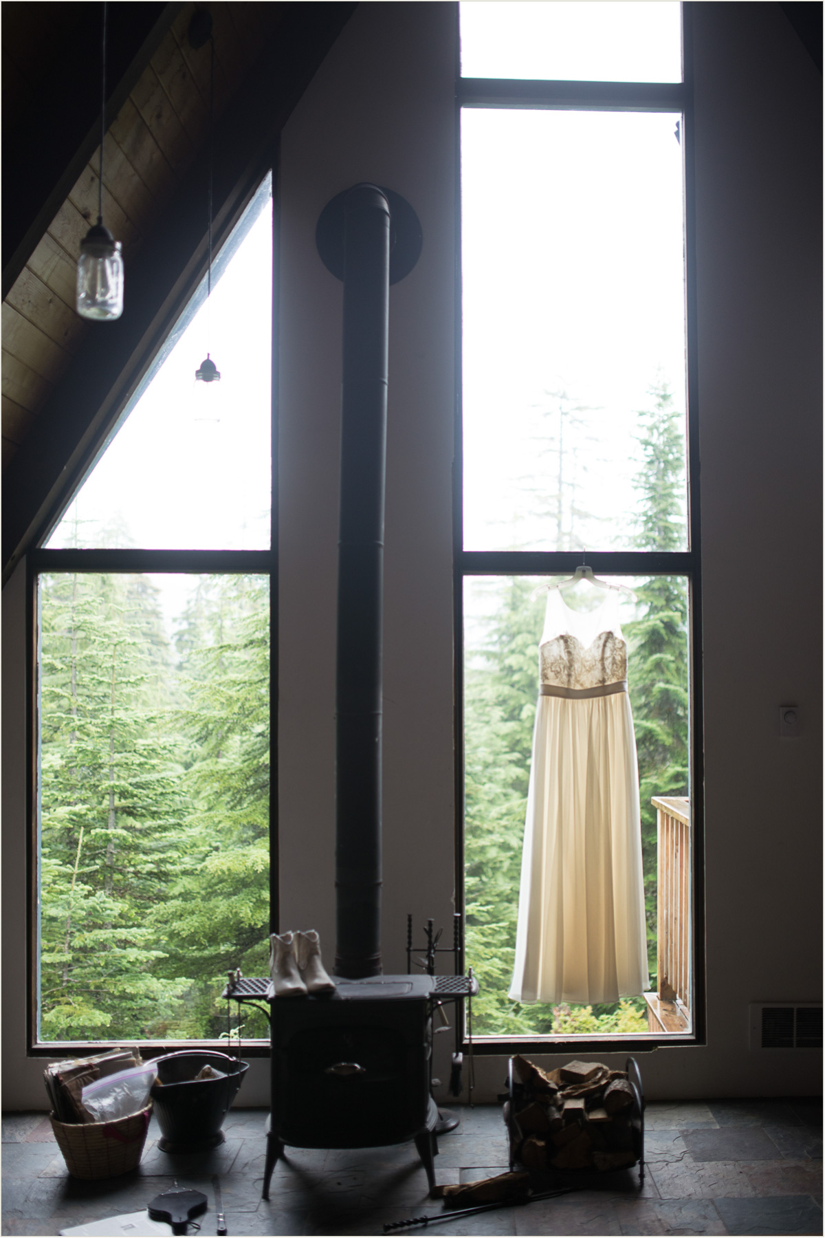 Wedding Dress Hanging in Window of Cabin