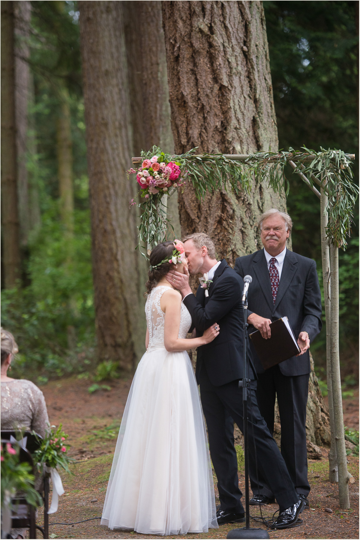 Couple Kissing under DIY Arbor