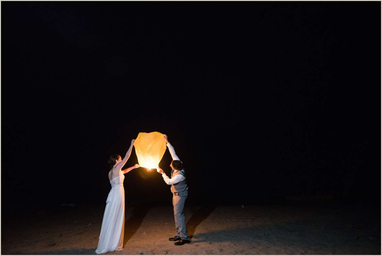 bride-and-groom-sending-off-paper-lantern
