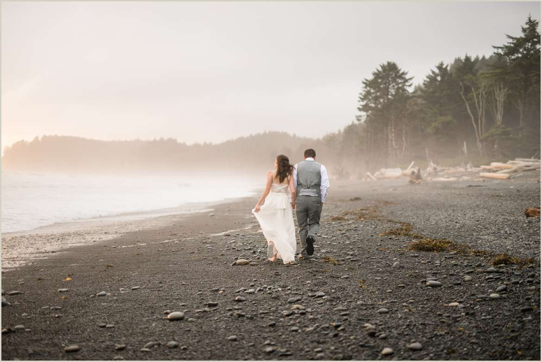 Bride and Groom Walking on Foggy Beach