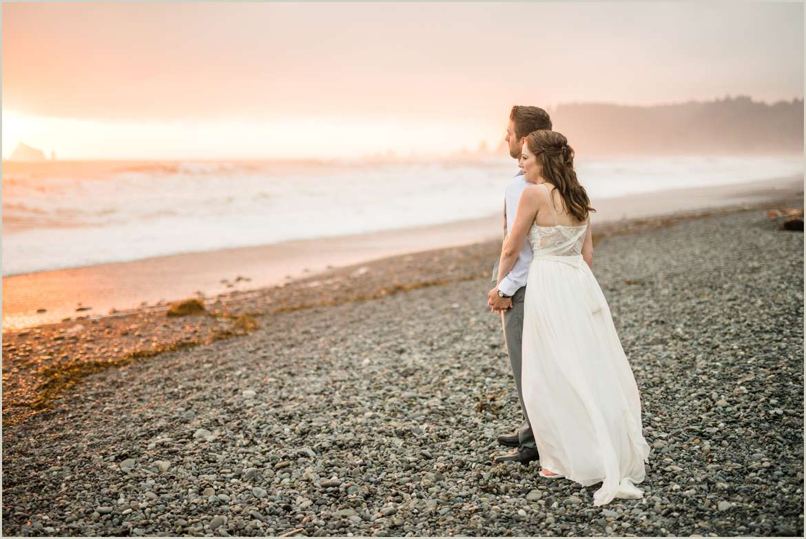 couple-watching-the-sun-set-on-their-wedding-day