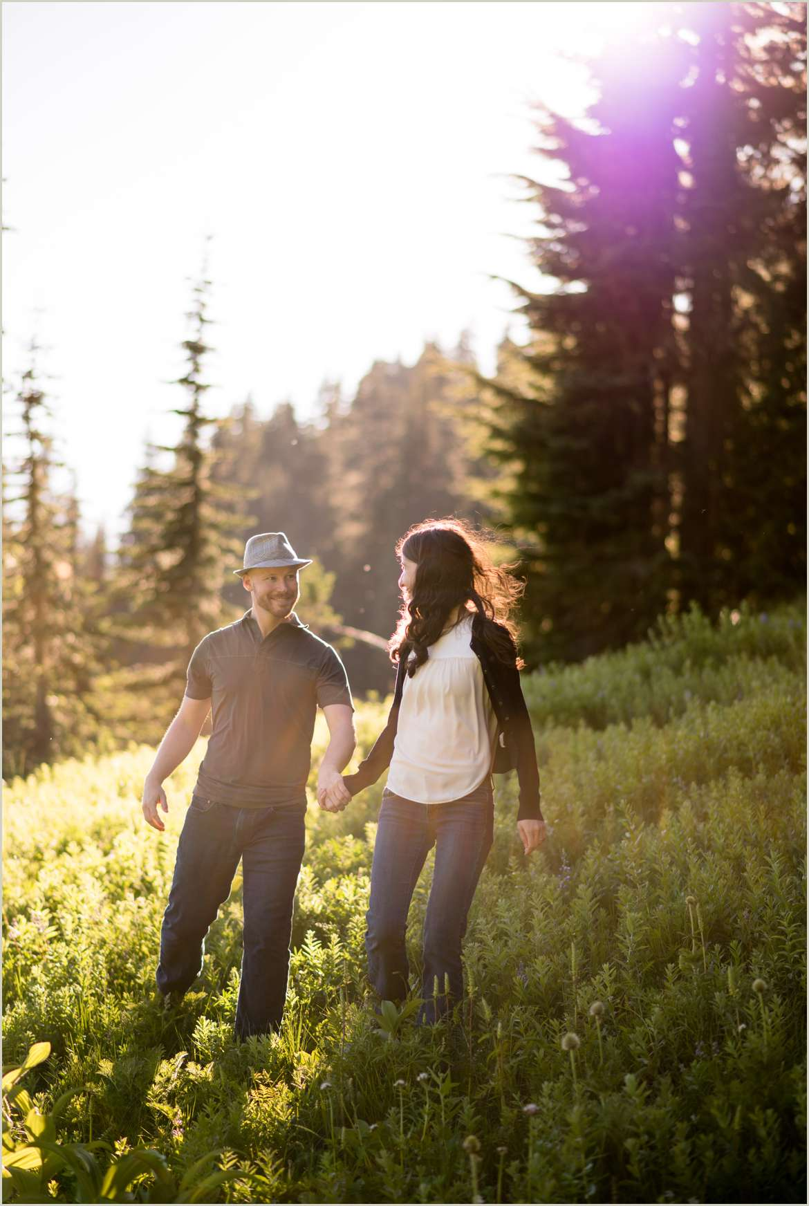 happy-couple-walking-in-the-mountains