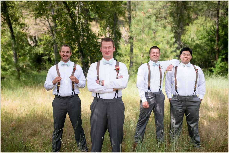 groomsmen-wearing-suspenders-and-bow-ties