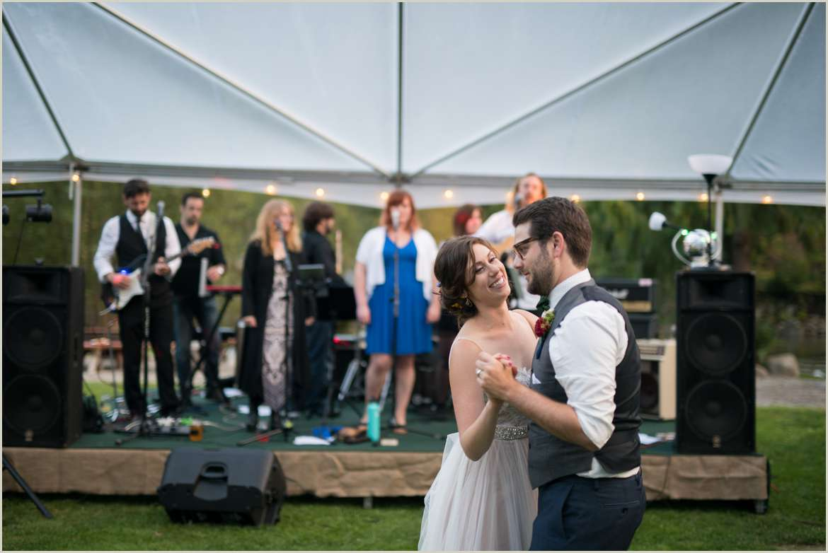 bride and groom dancing to live band