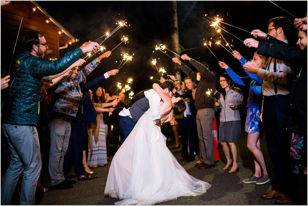 bride and groom kiss as they leave party