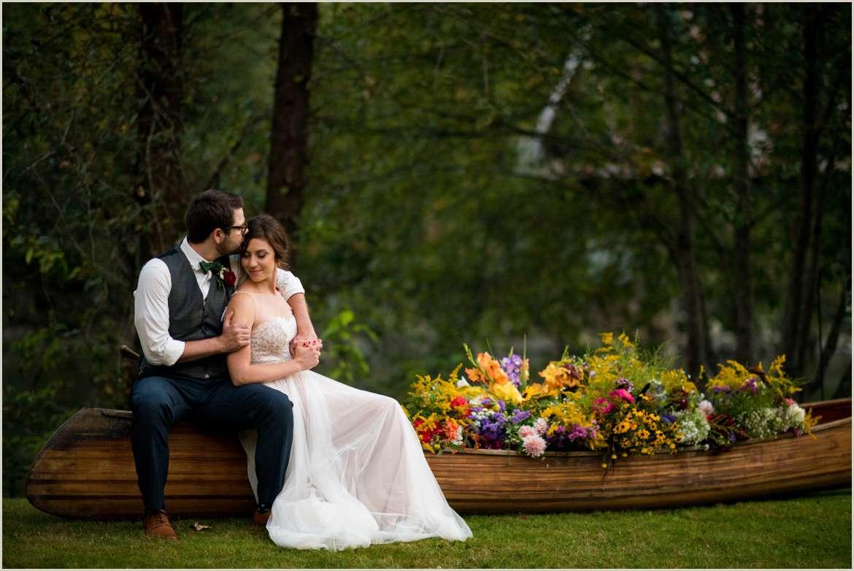 bride and groom photos with canoe