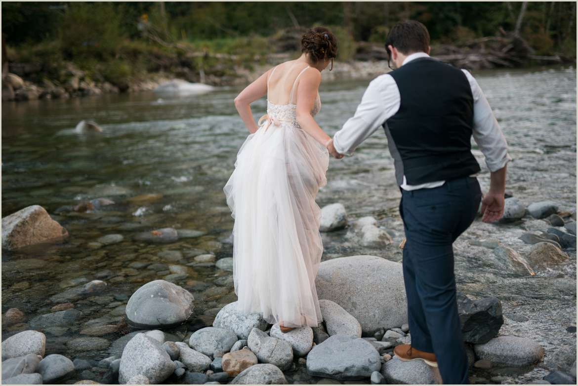 bride and groom venture out in river on wedding day