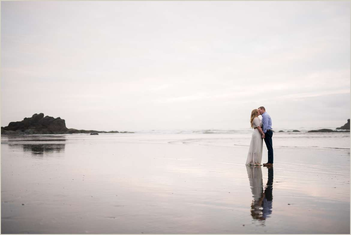 couple kissing with reflection on beach