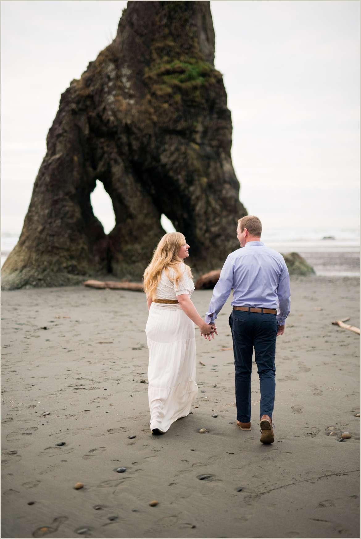 couple walking on pnw beach