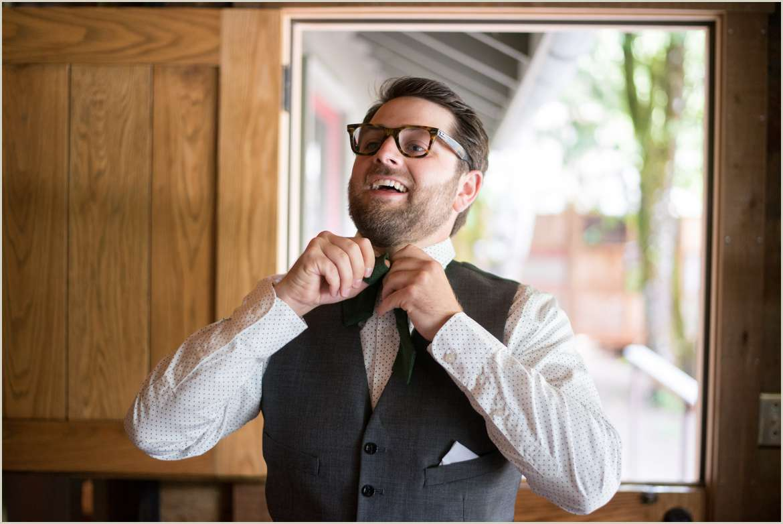 groom getting ready in cabin