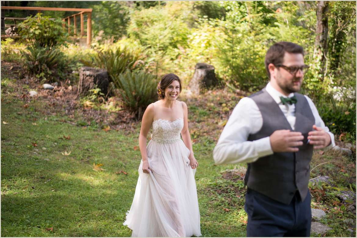 groom nervously waits for first look with bride