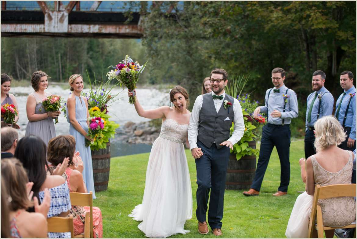 happy bride and groom walk down aisle seattle photojournalistic wedding photography