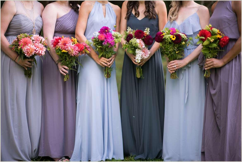 mismatched blue and purple bridesmaids dresses
