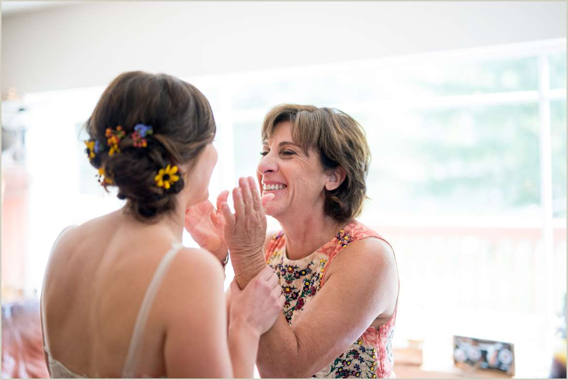 mother of the bride seeing her daughter in wedding dress