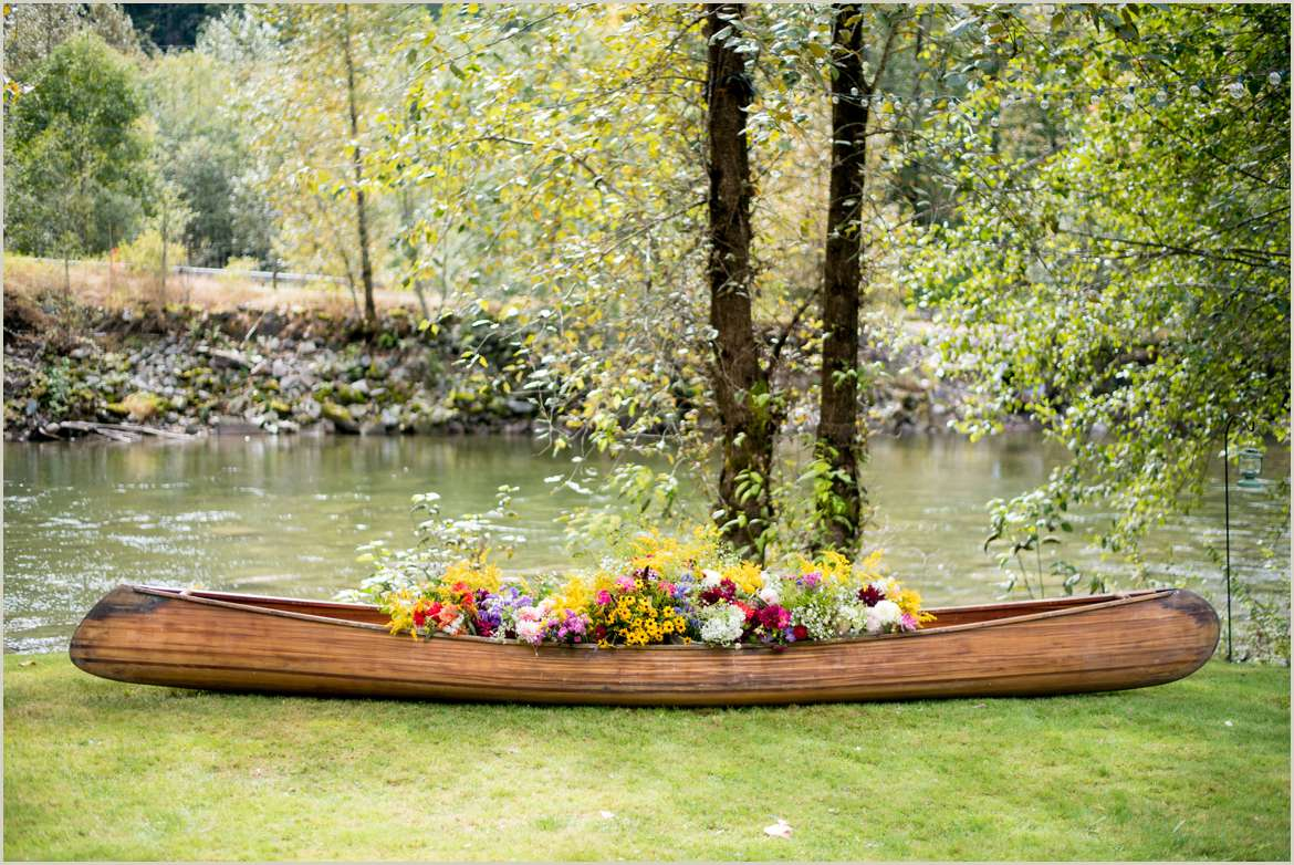 river wedding decorations canoe filled with wildflowers