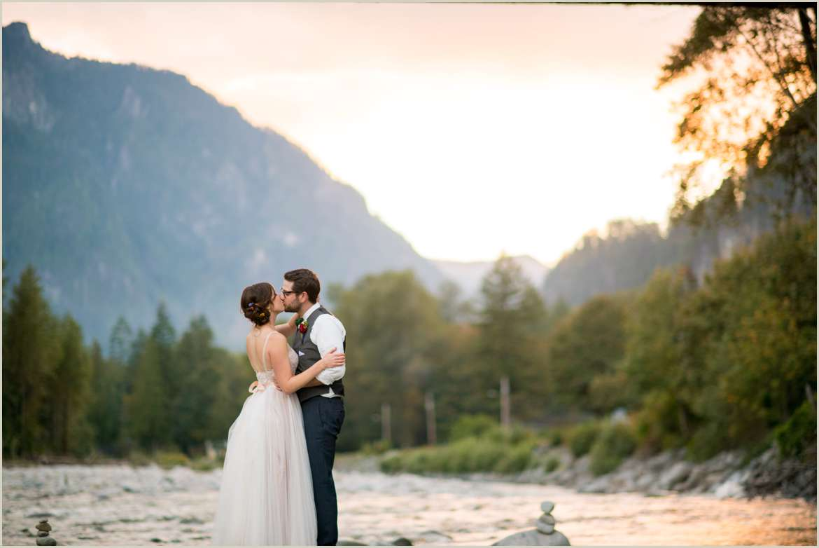 sunset photos of bride and groom on river