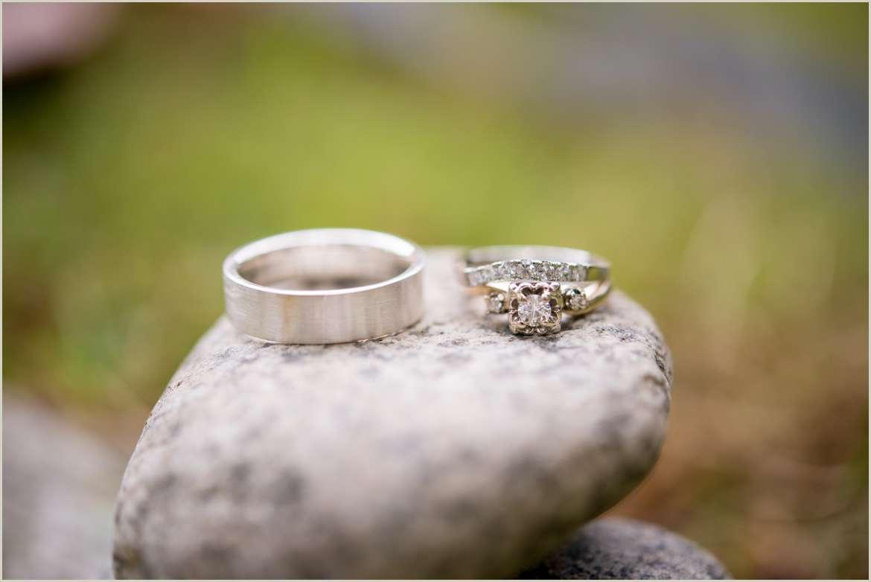 wedding rings on river rocks