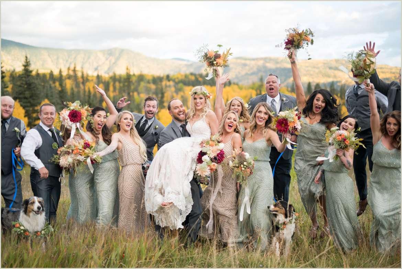 award winning photo of wedding party cheering