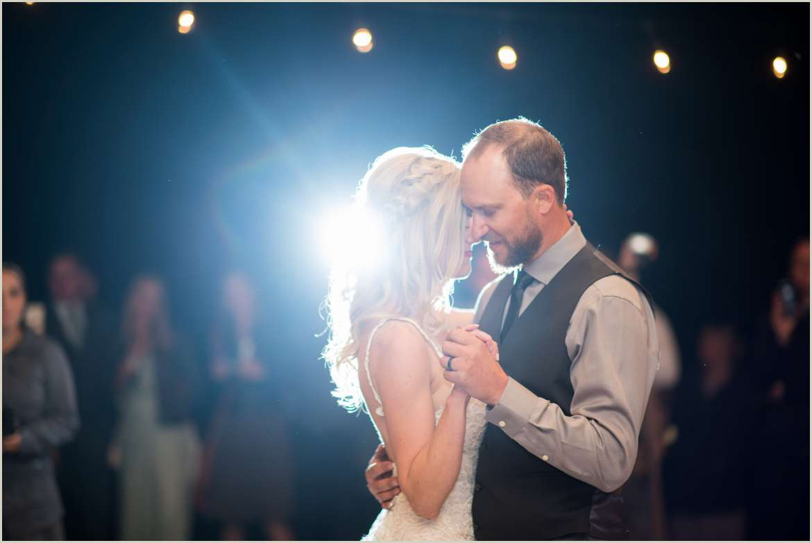 bride and groom first dance backlight