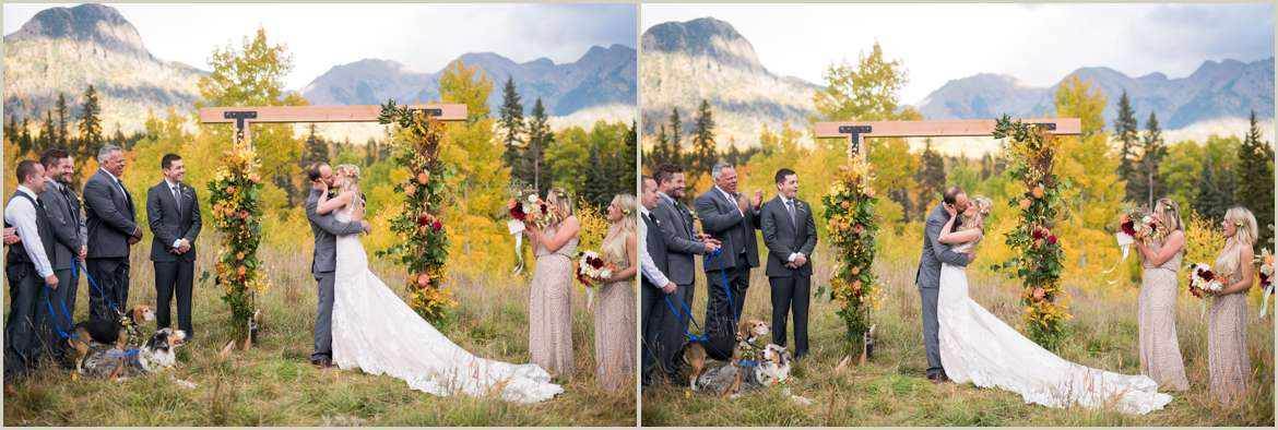 bride and groom first kiss on mountain