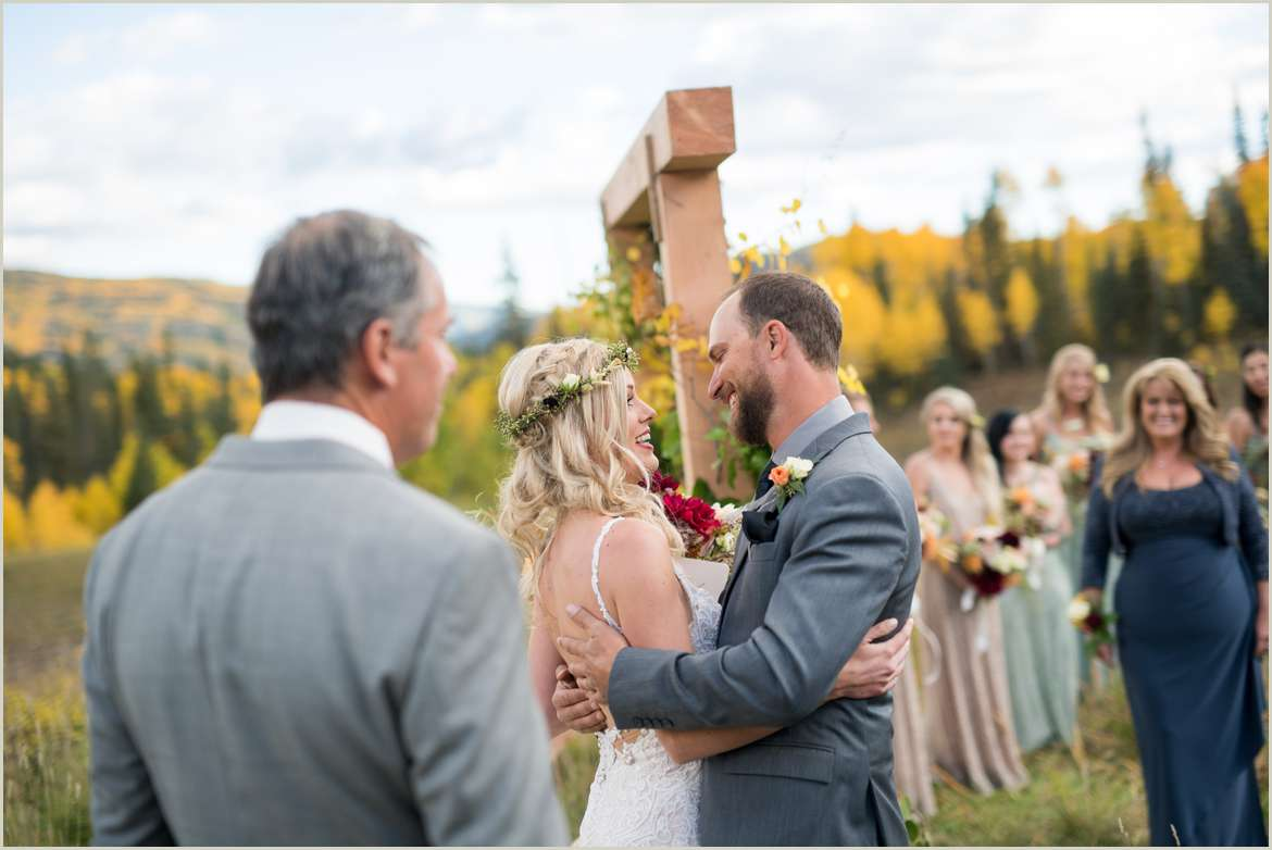 bride and groom greet each other at arbor
