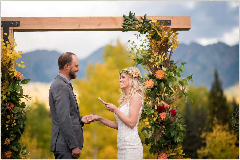bride and groom say vows in colorado rockies