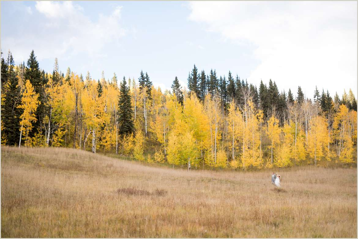 bride walking along mountainside to ceremony