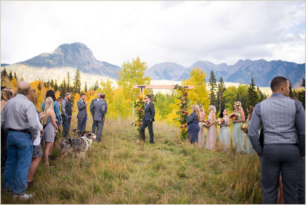 groom and guests wait for bride at ceremony