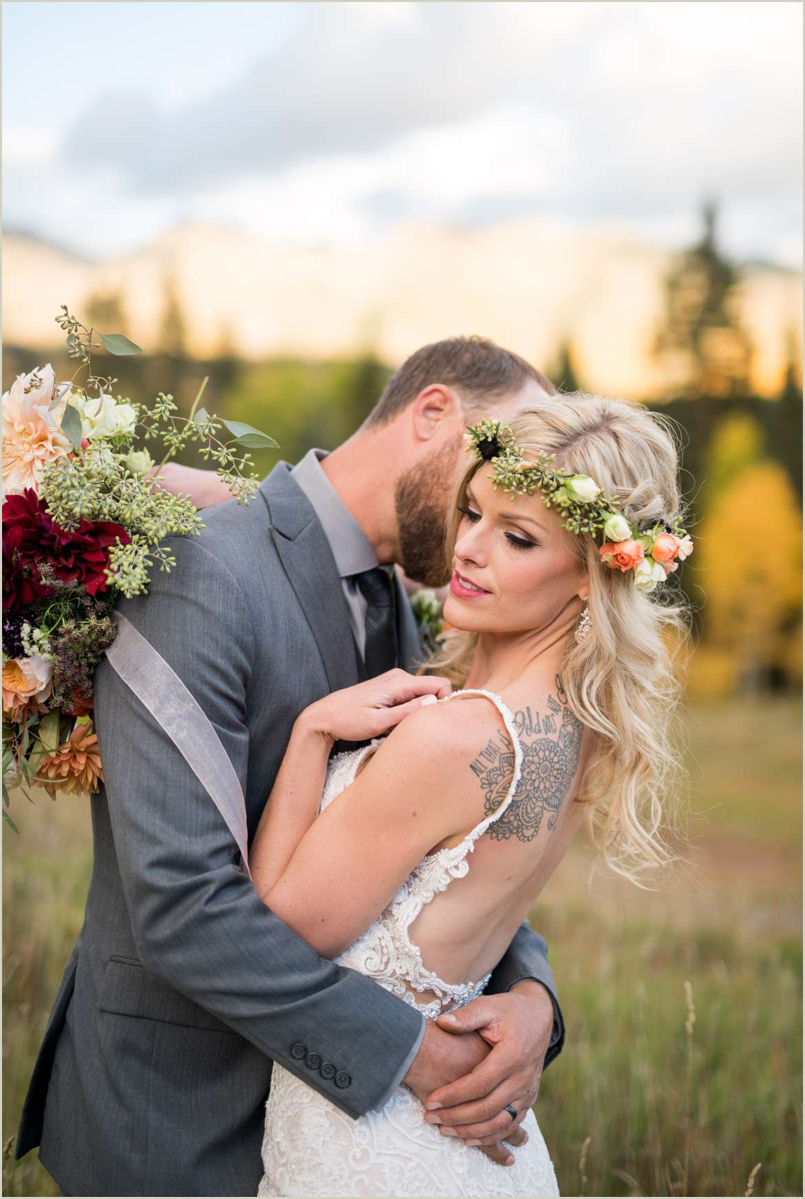 groom kisses bride on cheek