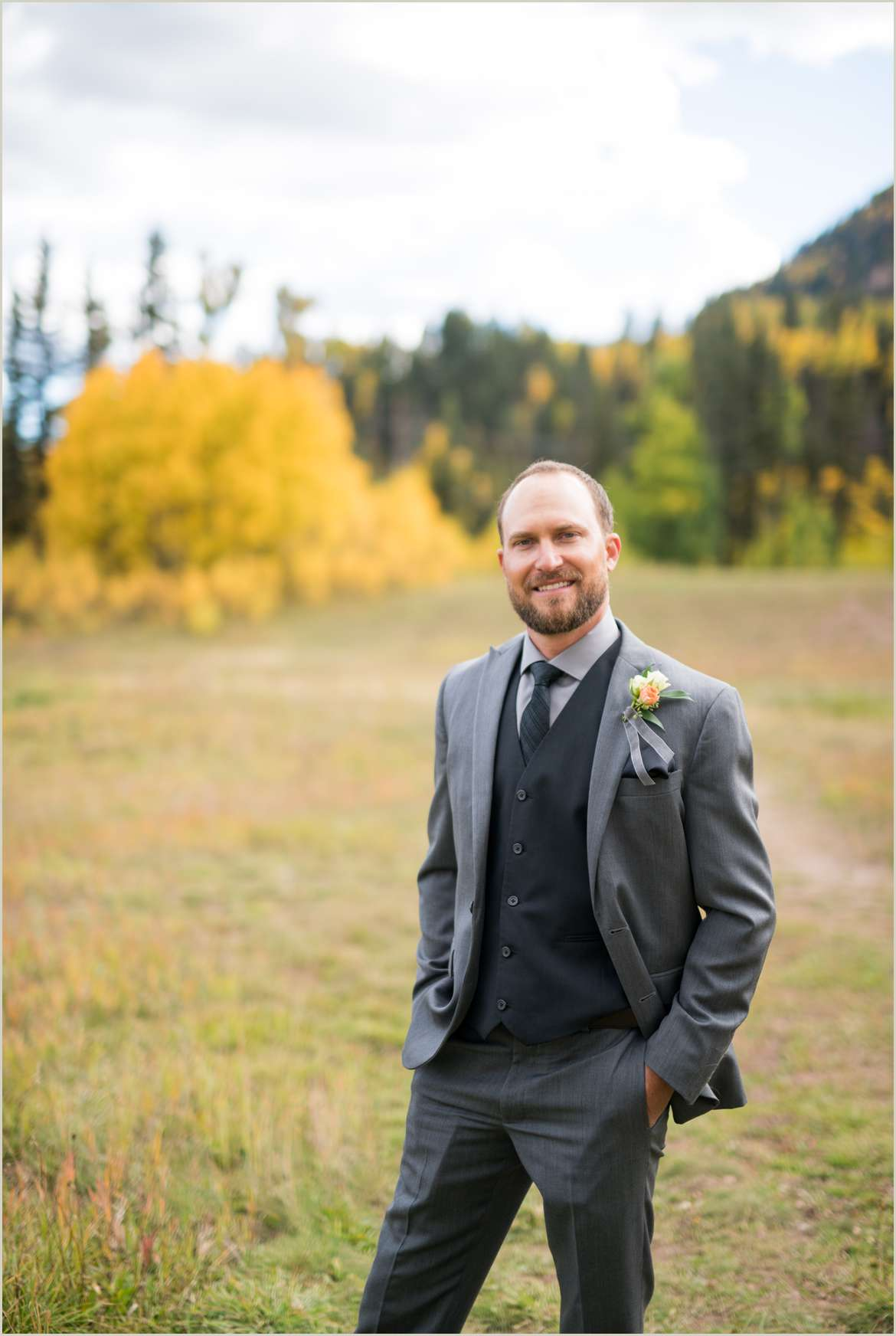 groom wearing grey suit